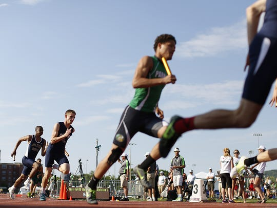 Runners compete in the WIAA state track and field meet at Veterans Memorial Stadium in La Crosse.