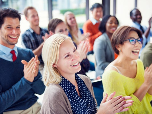 Group of Multiethnic Cheerful People Applauding