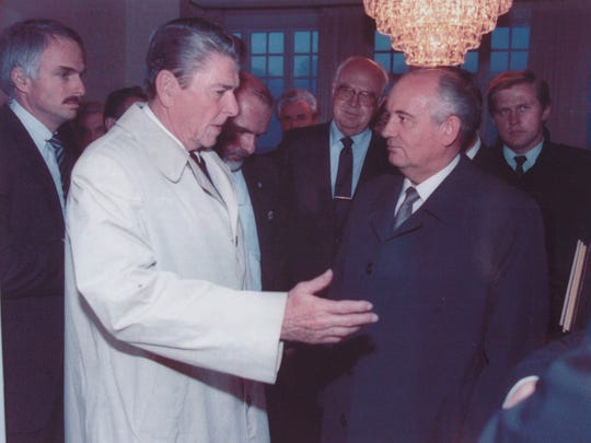 President Reagan speaks with Soviet leader Mikhail Gorbachev after their last meeting in Reykjavik on October 12, 1986.