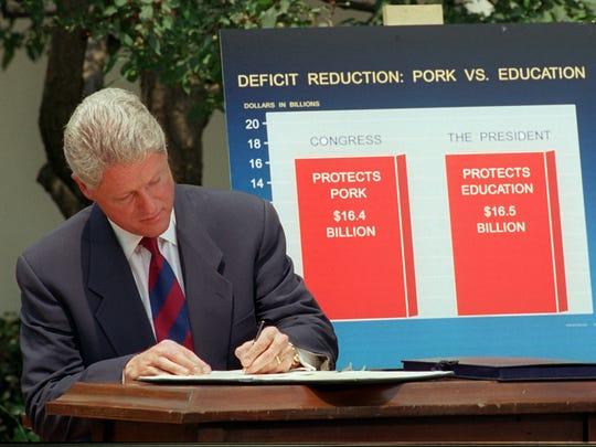 President Clinton vetoes a $16.4 billion spending cuts