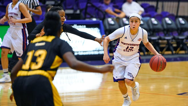Northwestern State's Janelle Perez drives against the Grambling defense.