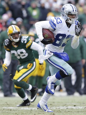 Dallas Cowboys wide receiver Terrance Williams (83) breaks free from a tackle attempt by Green Bay Packers cornerback Tramon Williams (38) and runs it in for a touchdown reception in the second quarter.