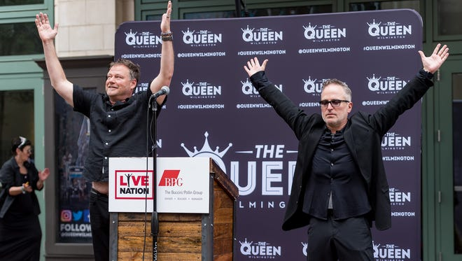 """Live Nation's Geoff Gordon (right) and Michael Grozier imitate the """"live guy"""" in the Live Nation logo as they announce the company's arrival at The Queen."""