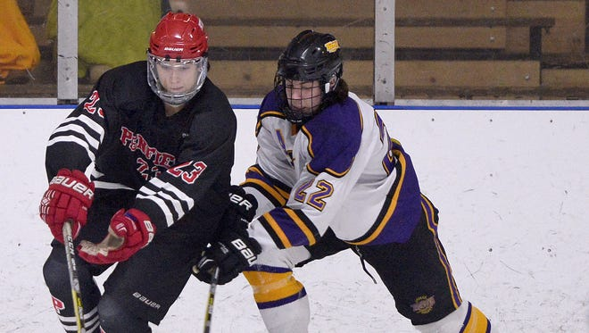 Penfield's Kyle Leatt, left, is defended by Greece Thunder's Carson Fotheringham during a regular-season game on Nov. 29. The Patriots play host to rival Fairport at 5 p.m. Tuesday at Webster Ice Arena.