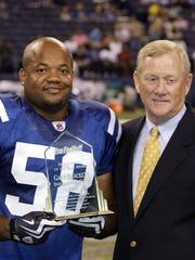 Indianapolis Colts President Bill Polian (right) congratulates