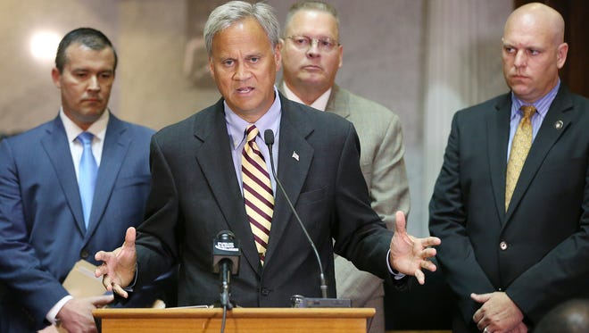 State Sen. Jim Merritt, an Indianapolis Republican, spoke at a news conference Tuesday, Aug. 2, 2016, at the Indiana Statehouse about planned legislation to protect public safety officials.