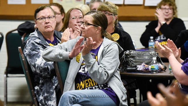 The audience applauds a speaker during a gathering of SEIU Healthcare union members and local health care advocates Monday, May 14, at the First Presbyterian Church.