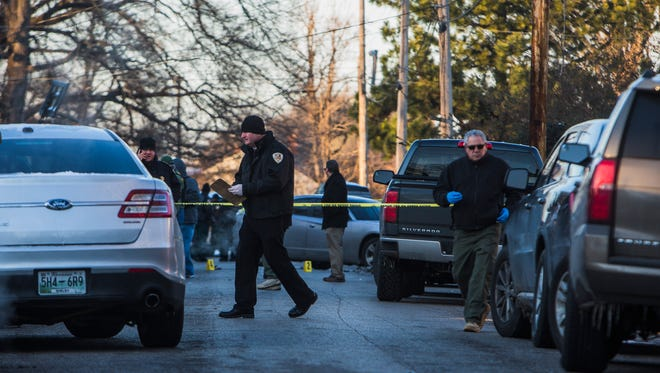 Officers work the scene of a police shooting that injured both a Shelby County Sheriff's deputy and another man in the 1100 block of Decatur in North Memphis on Jan. 17.