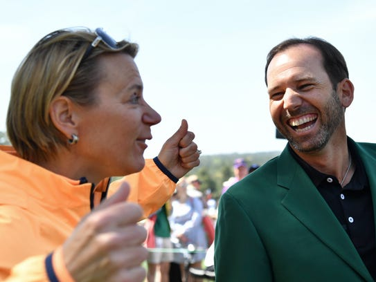 Apr 1, 2018; Augusta, GA, USA; Annika Sorenstam (left) shares a funny story with defending Masters Champion Sergio Garcia during the finals of the Drive, Chip & Putt competition at Augusta National GC.