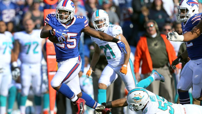 Bills running back LeSean McCoy breaks a tackle en route to a 48 yard touchdown run against Miami.  McCoy rushed for 112 yards in a 33-17 win.