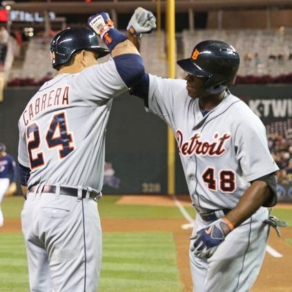 Detroit Tigers' Torii Hunter, right, and Miguel Cabrera celebrate Hunter's solo home run on Sept. 15, 2014, against the Minnesota Twins.