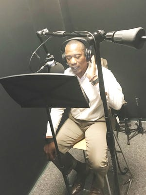 FAMU alum and professor Dr. James Moran reads his script as narrator for the documentary.