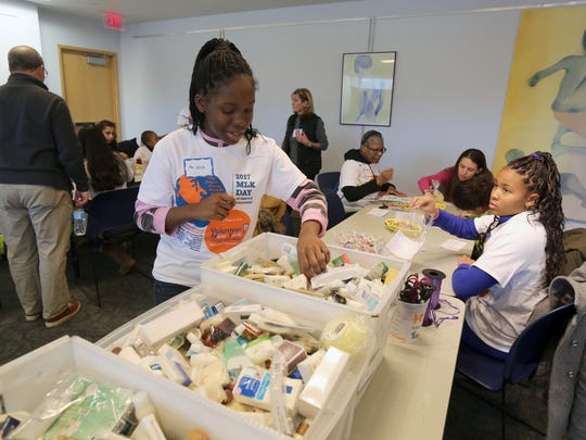 Aniaya Ferrer, 13, help assemble care packages at the Greenburgh Library in Elmsford, as part of the Volunteer New York Martin Luther King Jr. National Day of Service, Jan. 14, 2017.