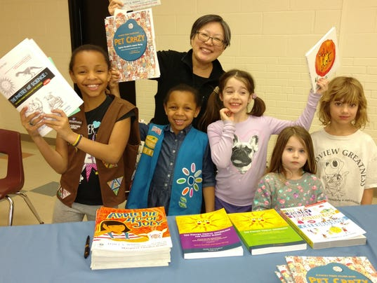 636595649884978385-Local-author-Janet-Wong-with-kids..jpg