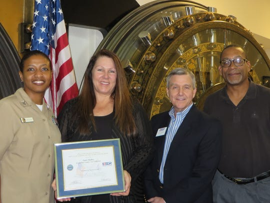 Left to right: PO 2nd Class Valeisa Jefferson, Escambia County Tax Collector Janet Holley, and ESGR representatives Timothy Lambert and Harry Thomas.