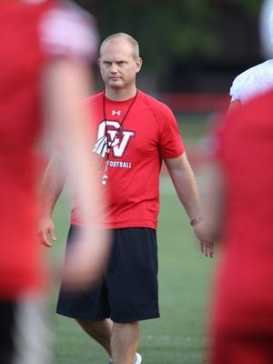 Chippewa Valley High School head coach Scott Merchant runs the team's first practice at the school in Clinton Township on Monday, August 10, 2015.   (ROB WIDDIS/Special to the Free Press)