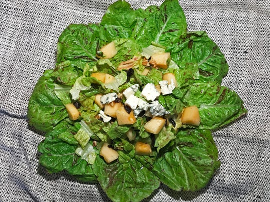 """Heirloom Romaine lettuce called """"Flashy Trout's Back"""" shows its best with this melon salad with walnuts, prunes, and Roquefort cheese"""