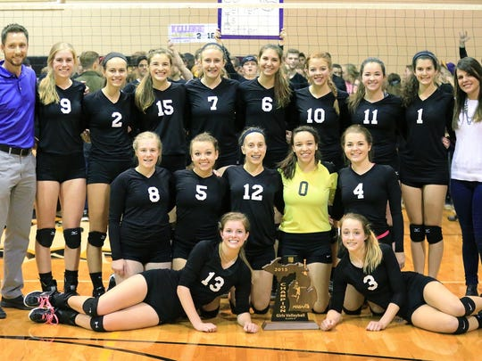 Plymouth Christian Academy's varsity girls volleyball team celebrates Nov. 12 after winning the Class D regional final. The Eagles competed Tuesday in a quarterfinal matchup.
