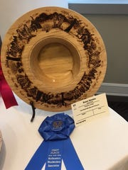 "Karen Amodeo's  ""Country Living"" earned a First Place ribbon in Pyrography during a spring exposition on woodworking."