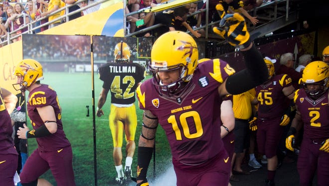 ASU safety Marcus Ball takes the field with his teammates before a game agains Washington on Oct. 19, 2013, at Sun Devil Stadium in Tempe.