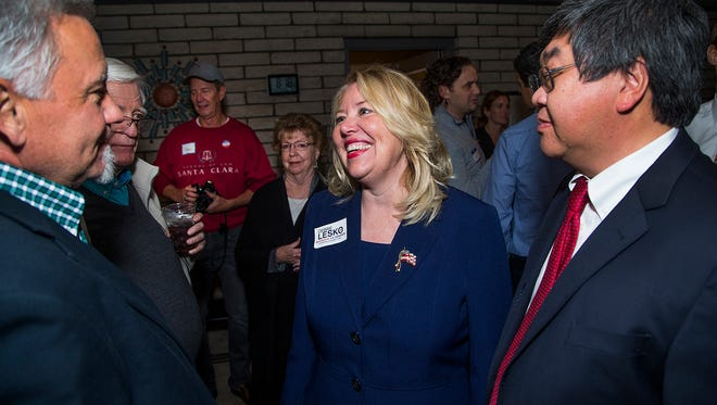 Debbie Lesko chats with supporters Stacey Meier (left) and Gilbert Wong  at her campaign gathering at her home in Peoria on Feb. 27, 2018.