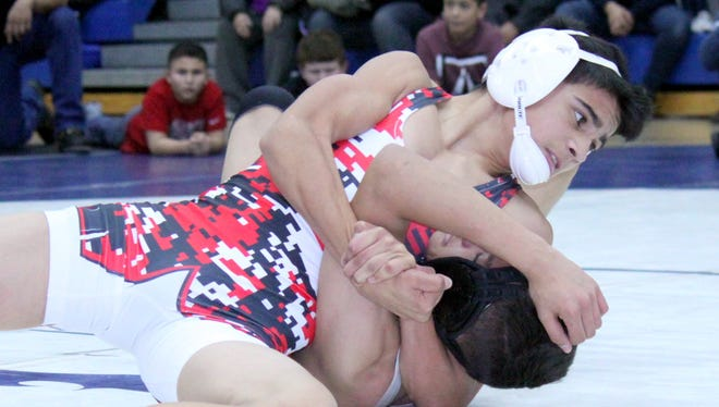 Cobre's Zeke Soliz had one of two pins for the Indians during Wednesday's dual against Silver. He pinned Vince Marin in the first period at 106 pounds.