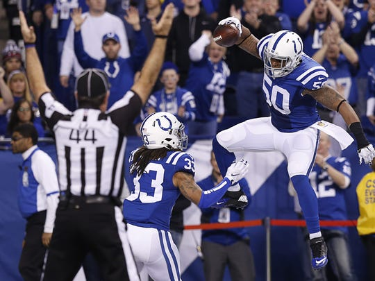 Indianapolis Colts inside linebacker Jerrell Freeman (50) celebrates after scoring a touchdown on an interception return against the Tennessee Titans at Lucas Oil Stadium on Jan. 3, 2016.