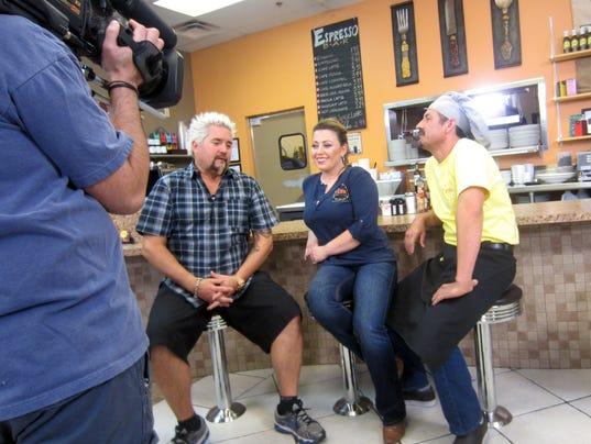 Guy Fieri, Perk Eatery owner Pauline Martinez and her husband/co-owner Carmen Martinez.