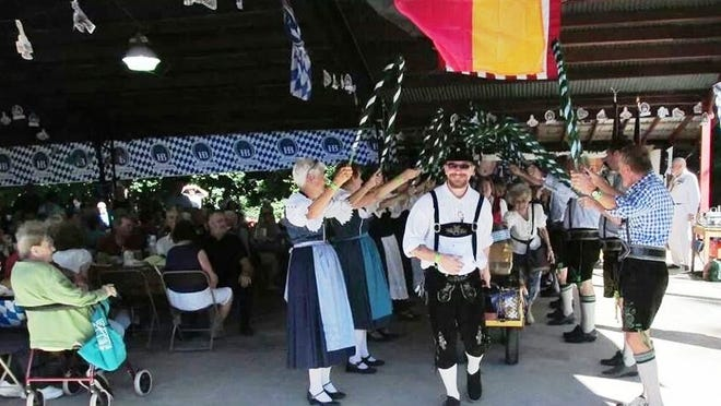 """Each day, Oktoberfest will open with an official """"tapping of the keg"""" and """"blessing of the bier."""" Bavarian dancers take part in last year's opening ceremonies."""