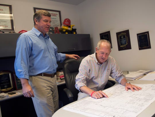Jeff Bishop, CEO of Maschmeyer (left), works with Troy