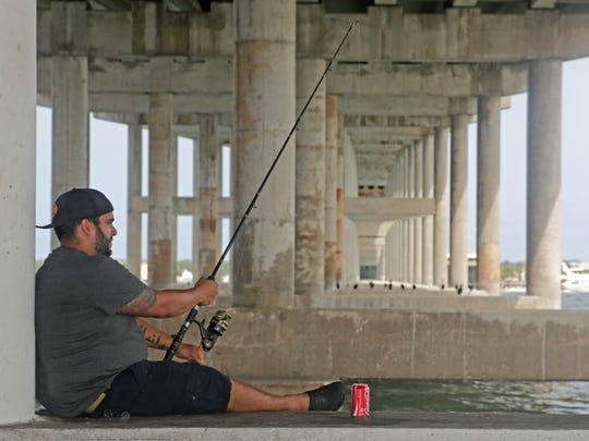 Manuel A. Mojena, of Miami, fishes under the Rickenbacker