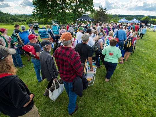Fans line up to enter Bob Dylan's concert at the Shelburne Museum on Tuesday, June 20, 2017.