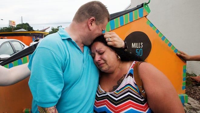 Gwen Blake, right, comforts Ben Johansen at The LGBT Center of Central Florida in Orlando on Sunday.