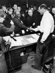 One day after the assassination of Dr. Martin Luther King Jr., Memphis Mayor Henry Loeb, a shotgun beneath his desk, greets about 300 black and white ministers in his office April 5, 1968, shaking hands with the Rev. Joseph P. Toney.