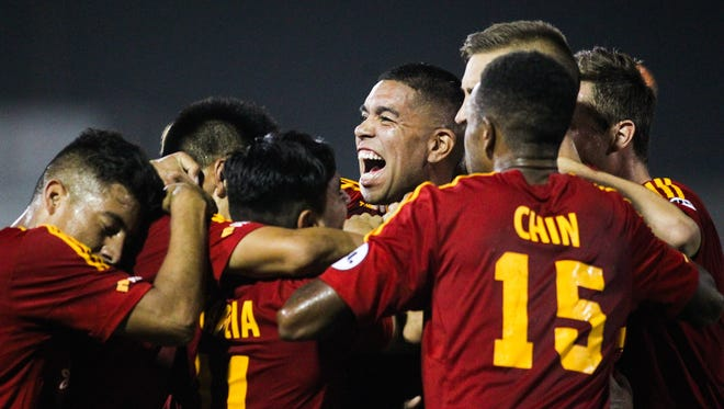 Arizona United players celebrate Long Tan's goal, the second of the night. Arizona defeated Seattle 2-1 at Scottsdale Stadium in Scottsdale, AZ, on Saturday, June 20, 2015.