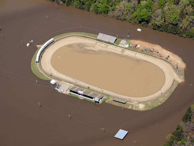 Water from the Pearl River, floods the Jackson Motor Speedway in Byram Wednesday, April 9, after heavy rains this week. Photo by Greg Campbell, Special to The Clarion Ledger.