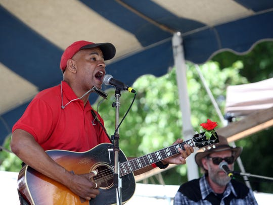 Guy Davis, left, shown performing in 2013.