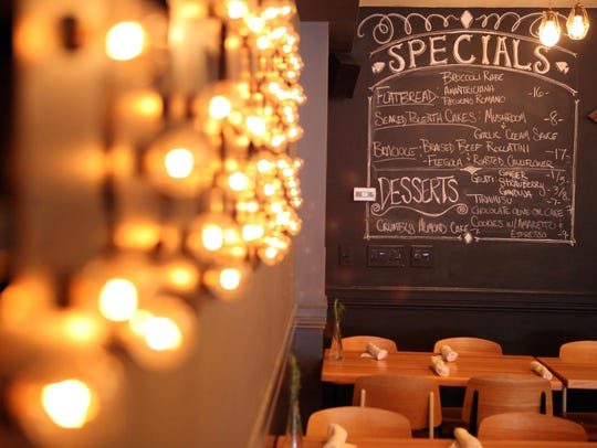 The specials are written on a chalkboard wall at Gleason's