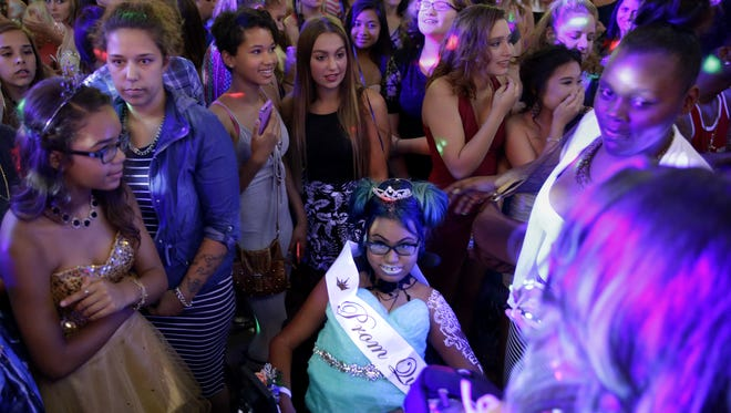 Jerika Bolen is surrounded by a sea of guests at her prom on July 22, 2016 at the Grand Meridian in Appleton.