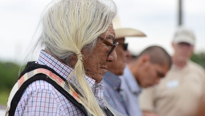 Northern Arapaho elder Mark Soldier Wolf stands with fellow elder Hubert Friday and Devin Oldman during the unveiling of a sign commemorating the site known as Council Tree. The historical site is where tribes gathered before settlers came to the Poudre Valley.