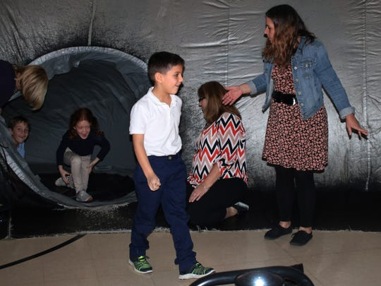 Students at Immaculate Conception School were in awe as they stepped inside the 'Sky Dome' planetarium before the lights are turned out to view the night's sky.