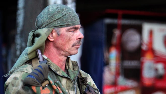 A Russian-backed separatist mans a checkpoint about 30 miles from the rebel-stronghold of Donetsk in eastern Ukraine on July 24, 2014.