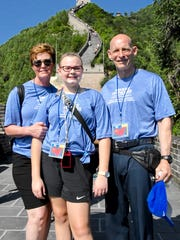 Alexis Huber and her mom Shelly and dad Keith, at a