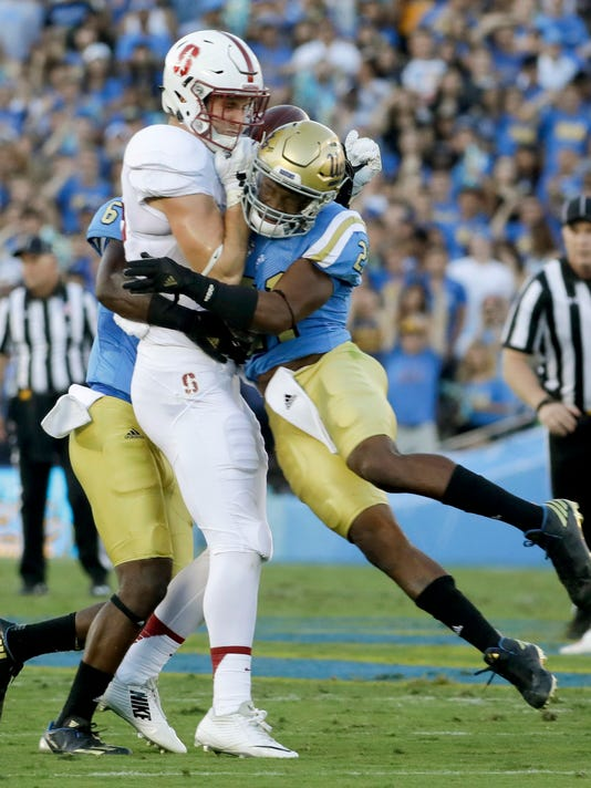 Stanford wide receiver Francis Owusu, left, can't hold on to pass under pressure from UCLA defensive back Tahaan Goodman during the first half of an NCAA college football game in Pasadena, Calif., Saturday, Sept. 24, 2016. (AP Photo/Chris Carlson)