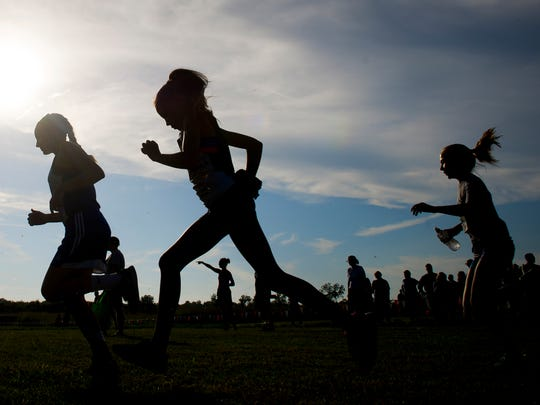 Runners prepare for the girls varsity 3k race during the 7th annual Run at the Mounds cross country meet for middle school runners at Angel Mounds in Evansville on Tuesday.