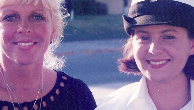 Dusty Donaldson and Kimberly Lester at Lester's graduation from Navy boot camp in 1996.