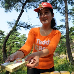 A vendor sells a box of Yangchunsamnok, a North Korean version of Viagra, for $10 near a scenic spot at the Mount Kumgang international tourist zone in North Korea on Sept. 1, 2011.