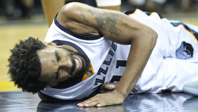 Memphis Grizzlies guard Mike Conley (11) is injured on a play in the third quarter against the Charlotte Hornets at FedExForum.