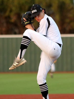 Rider's Jakob Kroupa, shown pitching against the Wichita Falls High School Coyotes March 17, combined with two other pitchers to shut out Braswell Friday night.
