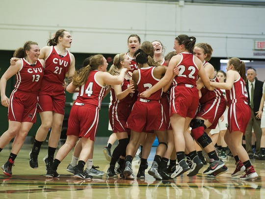 CVU celebrates the championship during the division I girls basketball championship between the Champlain Valley Union Redhawks and the St. Johnsbury Hilltoppers at Patrick Gym on Saturday afternoon March 18, 2017 in Burlington.